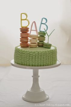 baby shower peaches and cream layer cake with macarons and handmade fondant letter toppers