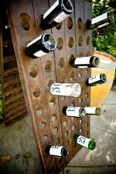 """This is a great idea for a wedding guest book: An antique French riddling rack filled with 10 numbered wine bottles labeled 1, 2, 3, 4, 5, 10, 15, 20, 25 and 30. Guests leave notes in the bottle of their choice and on the year that corresponded to the bottle the couple would crack it open and enjoy their unique """"guestbook"""" for years to come!"""