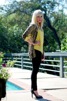 She's wearing some must-have pieces - skinny black pant, yellow blouse, black pumps and a leopard cardigan.