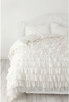 LOVE this ruffle bedspread... it would kinda make up for all the structured dark furniture I've got going on...