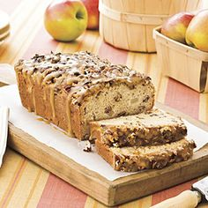 Praline-Apple Bread   MyRecipes.com 1 1/2 cups  chopped pecans, divided   1   (8-oz.) container sour cream  $     1 cup  granulated sugar  $     2   large eggs  $     1 tablespoon  vanilla extract   2 cups  all-purpose flour   2 teaspoons  baking powder   1/2 teaspoon  baking soda   1/2 teaspoon  salt   1 1/2 cups  finely chopped, peeled Granny Smith apples (about 3/4 lb.)  $     1/2 cup  butter  $     1/2 cup  firmly packed light brown sugar