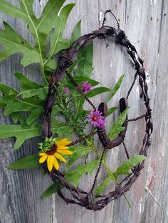 Antique Barb Wire wreath with hand forged horse shoe. Rare 19th century single stand spiral wire. Very Prairie Couture.