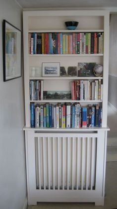 radiator cover with shelves above....maybe something like this for bathroom...