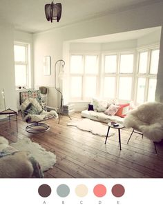 white room with sheep skins and big windows by photographer kat heyes