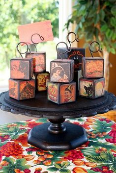 Halloween picture holders made with wood blocks, scrapbook paper and a wire holders.