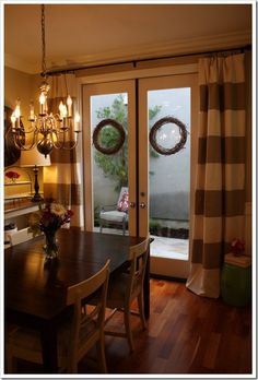 I like the single drapery rod and full drapes over the French doors, rather than the usual two smaller curtains set on top/bottom tension rods over the window grass only.