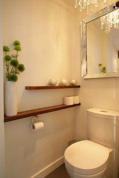 Long shelves, mirror behind toilet