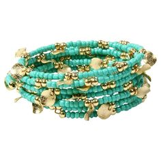 A bold anchor for bright ensembles and neutral outfits alike, this coiled bracelet showcases gold-tone brass flakes and turquoise-hued beads.  ...