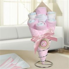 Cowgirl baby shower Diaper Bouquet.  Visit us at http://www.modern-baby-shower-ideas.com/western-baby-shower.html Use coupon code: Modern11 and save 11%