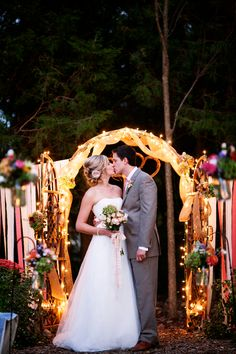 lit up ceremony arch for night time weddings