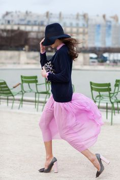 pink skirt. black hat. gorgeous.