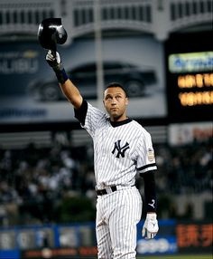 Derek Jeter waves to the fans after geting his 3000 hit, a home run into the left field stands. #nyy