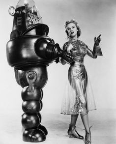 Robby the Robot poses with co-star Anne Francis in this shot for 1956's Forbidden Planet, a retelling of Shakespeare's The Tempest.