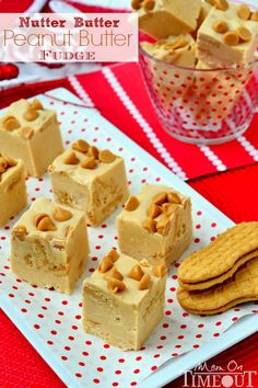 This Nutter Butter Peanut Butter Fudge is perfect for peanut butter lovers!  Ultra smooth peanut butter fudge filled with Nutter Butter Cookies. Yep! Fudge just got better! | MomOnTimeout.com