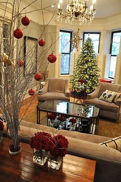 DIY ~ Spray painted white branches, a tall vase and some red ornaments ~ now to steal them branches from @Melanie Bauer Bauer Bauer Segur