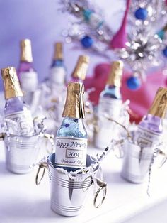 Use mini champagne bottles as party favors! #newyearseve #holiday #party #tip