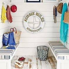 This mudroom is the perfect spot to stash beach-day necessities, from suits to sandals and more. The home's nautical theme is evident here, with classic blue stripes, white-washed floors, and a life preserver. Coastalliving.com
