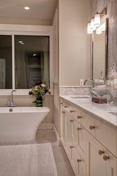 Suzie: Shuffle Interiors - Master bathroom with cream double bathroom vanity with double sinks, ...