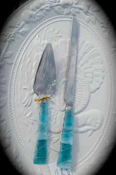 """Sea Glass Wedding Cake Knife & Server made with Recycled Bottle """"Tumbled Island Glass""""  in Sea Foam Teal Green. Dishwasher Safe Stainless. $48.00, via Etsy."""