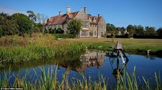 Pond: A miniature lake with a bird house takes up part of the land surrounding the mansion