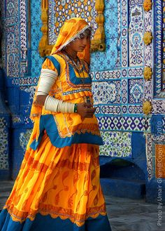 RAIN OF COLOR by Ghani, Umair on Flickr.  Photographer's Note: Hindu woman visits shrine of Sachal Sarmast in Sindh, Pakistan