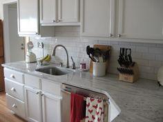 white river granite / white subway tile / white cabinets