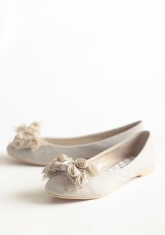 Taupe faux leather ballet flats.