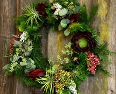 Wreath: evergreens, airplants, berries and succulents. Dig Garden Nursery, Santa Cruz.