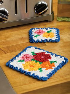 This is such a cool pattern! Doesn't even look like crochet. Actual pattern can be downloaded here:  http://www.coatsandclark.com/Crafts/Crochet/Projects/HomeDec/LC2188+May+Flowers+Hot+Pad+and+Coaster+Set_.htm