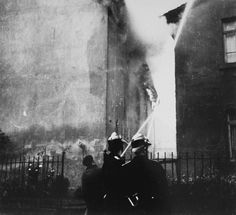 On the morning after Kristallnacht local residents watch as the Ober Ramstadt synagogue is destroyed by fire. The local fire department prev...