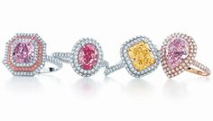 Rings from Tiffany's Blue Book collection feature rare pink- and yellow-diamond center stones surrounded by white diamonds.
