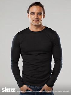 Dustin Clare in black.He plays Gannicus in Sparticus