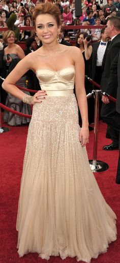 Miley Cyrus at the Academy Awards in 2010 wearing Jenny Packham