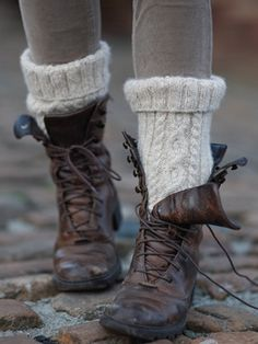 Rustic distressed Leather lace up boots with chunky cable knit socks and tights/leggings.