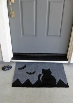 stenciled doormat using outdoor carpet, freezer paper for stencil, and leftover house paint