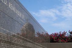 """Vietnam War Memorial Wall of Names at the Minnesota State Capitol. The list of names of the Minnesotans lost in Vietnam is prefaced by the Archibald MacLeish quote, """"We were young. We have died. Remember us"""". Photo Credit: Sam Fettig."""