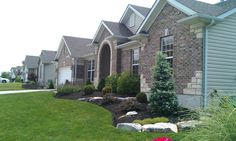 Front Yard Grass, Front Yard Evergreens  Front Yard Landscaping  Action Landscaping, Inc.  Imperial, MO