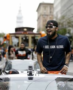 Giants relief pitcher Sergio Romo displays a message on his shirt that drew much attention at Wednesday's festivities. Photo: Marcio Jose Sanchez, Associated Press / SF