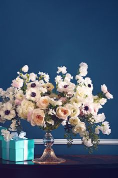 Garden roses, peonies and anemones in a color palette of white and soft pink create a graceful centerpiece or bouquet.