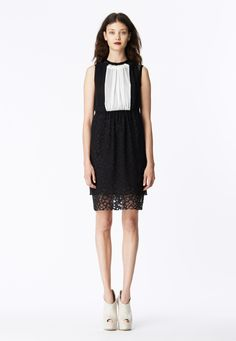 LOOK 15 Black and white silk chiffon bi-color gathered neck shift dress layered over black stretch net t-shirt dress with black honeycomb lace skirt.