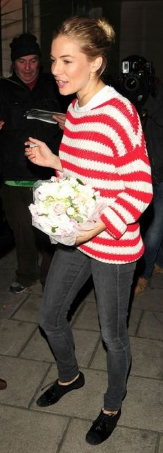Who made Sienna Miller's black lace up shoes and red and white sweater that she wore in London on March 7, 2011?