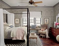 To balance the wallpaper's bold pattern, the fabrics in the master bedroom remain pale but textured.