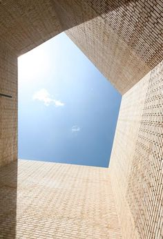 A five-sided pavilion made from pale sandy brickwork leads inside this former textile factory | Dezeen.com