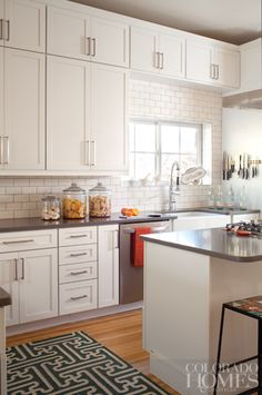 subway tile backsplash in white kitchen...love the upper cabinets for more storage instead of dust catching chachki ledge