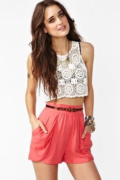 Amazing coral high-waist shorts featuring draped front pockets. Gathered detail at waist, zip closure at back. Unlined. Perfect paired with a crop knit and wedges!