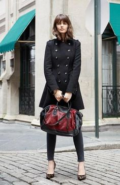 Black from head to toe with a cranberry handbag pop.