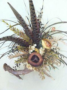 Rustic Décor - Deer Antler Floral Arrangement by  Greatwood Floral Deisgns.