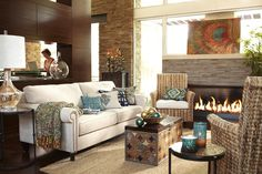 Pier 1 living room featuring the Alton Sofa in Ecru and the Surat Trunk