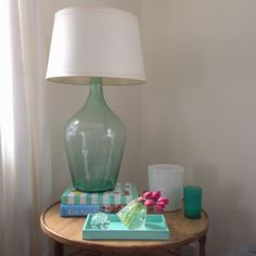 """DIY Demijohn Lamp. You Need: Demijohn, Clear Electrical Cording, Bottle Wiring Kit, Oversized Washer Compatible with Bottle Mouth Dimension, 8"""" Harp and Finial, Lampshade. Take cord out, take a minute to pull the cord straight. Wire socket and put it back together. Put threaded rod in to socket base, put harp base on threaded rod and tighten washer under that. Glue assembly to the opening of the bottle with clear silicone."""