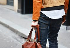 layers of sweater/white shirt/ jacket/ gloves creating a cool silhouette